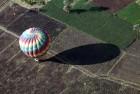 A hot air balloon lands near Luxor in Egypt.
