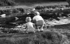 Two intrepid explorers watch their entries race by at the Yelverton Duck Race.
