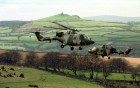 Two Lynx helicopters of the Army Air Corps prepare to land near Brentor on Dartmoor.