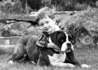 Richard Abraham of Gunnislake in Cornwall with his Boxer, Buster who survived an 80 foot cliff fall.
