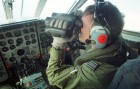 The co-pilot of a Royal Air Force Nimrod seeking visual confirmation.