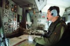 Air electronics operator aboard a Nimrod aircraft of the Royal Air Force.