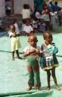 Refugee children wearing Western aid clothing in an orphanage in Rwanda.