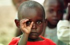 The photographer photographed. Boy orphaned by the war in Rwanda at a refugee camp near Goma in Zaire.